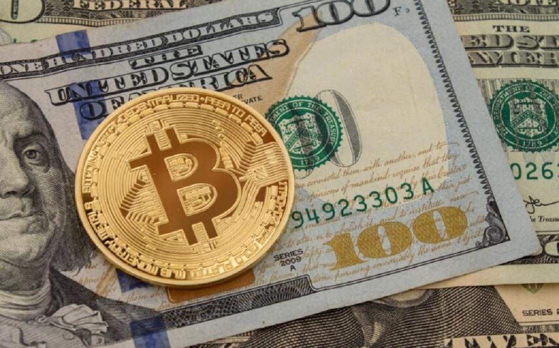 الدولار يستقر قرب قمة 14 شهرا وبتكوين عند أعلى مستوى في 5 أشهر فوق الـ 55 ألف دولار